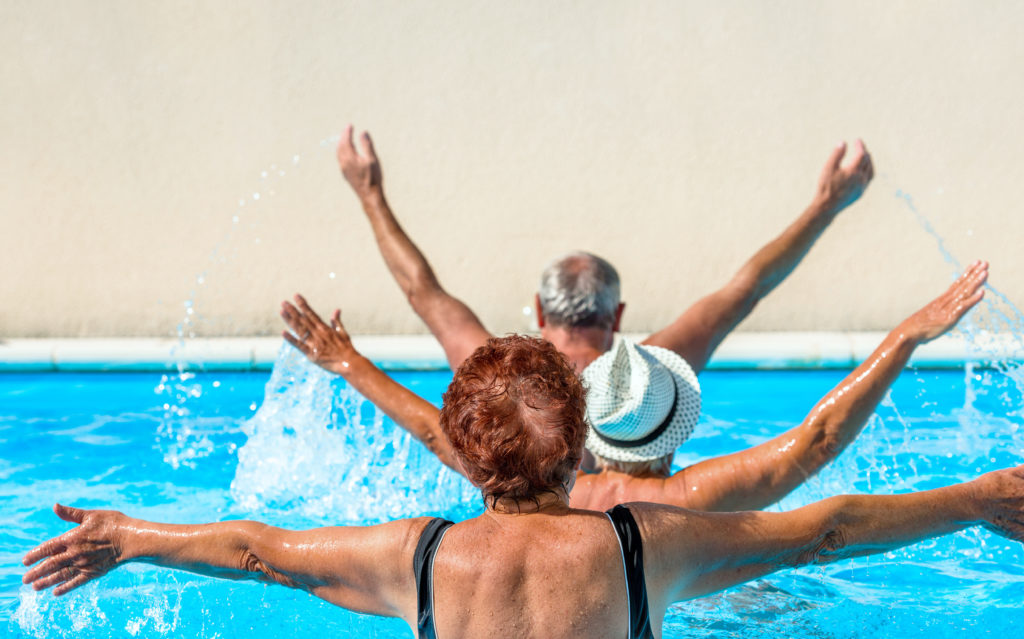 Elderly people participate in water aerobics.